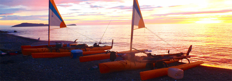 Hobie Cats on the beach at sunset